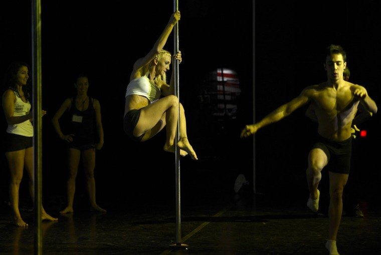 Pole dancers test the pole backstage during the Miss Pole Dance Argentina and South America 2012 competition in Buenos Aires on November 26, 2012. (Juan Mabromata/AFP/Getty Images)
