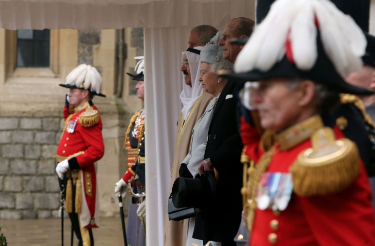 Britain's Queen Elizabeth II (3-R), the Emir of Kuwait, Sheikh Sabah al-Ahmad al-Sabah (3-L) and Prince Philip, the Duke of Edinburgh (2-R) look on during a welcoming ceremony at Windsor Castle in Winsor. The Emir of Kuwait is on a state visit to Britain. (Steve Parsons/AFP/Getty Images)