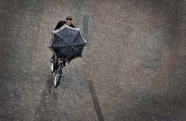 A man rides a bicycle on a snowy day in Munich, southern Germany. (Victoria Bonn-Meuser/Getty Images)