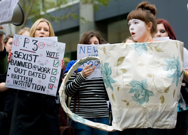Feminist campaigners protest outside the UK offices of News International in east London on November 17, 2012 against the continued use of topless photographs of women on page 3 of 'The Sun' newspaper. A new wave of feminism has taken hold in Britain this year: young, irreverent, and fuelled by social media. (Leon Neal/AFP/Getty Images)