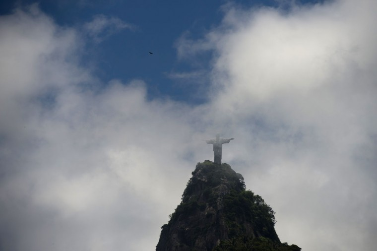The statue of Christ the Reedemer is seen surrounded by clouds, in Rio de Janeiro, Brazil, on November 29, 2012. (Christophe Simon/AFP/Getty Images)