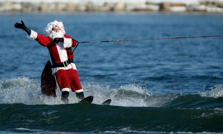'Water-Skiing Santa' cruises on the Potomac River December 24, 2009 in National Harbor, Maryland. This is the 22nd anniversary of the aquatic Christmas show. (Chip Somodevilla/Getty Images)