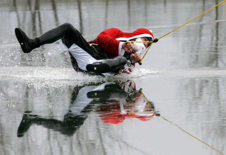 A participant in the wakeboard-Santa Claus contest slides over the ice in the eastern town of Grossbeeren, Germany on December 4, 2005. (Michael Urban/AFP/Getty Images) ORG XMIT: BER022