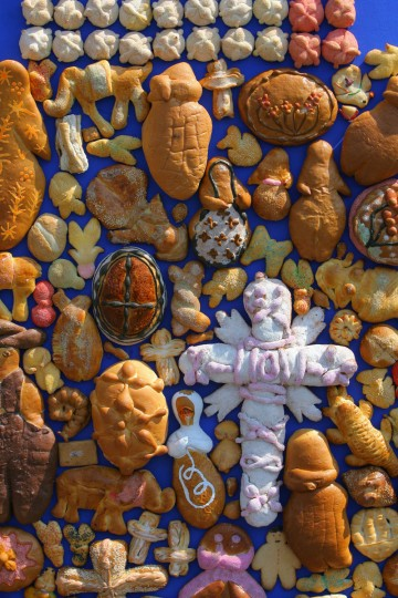 An offering to the death made with Day of the Dead bread is displayed 01 November, 2006 at the Mexico City's Zocalo (main square) in the framework of the Day of the Dead celebrations. (Omar Torres/AFP/Getty Images)