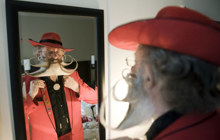 Germany's Gerhard Knapp prepares ahead of the World Beard and Moustache Championships in the northern city of Trondheim, on May 15, 2011. (Jonathan Nackstrand/AFP/Getty Images)
