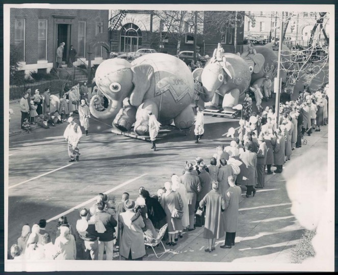 1958: Revelers look on at festive floats at the Toytown Parade. (Ralph Robinson/Baltimore Sun)