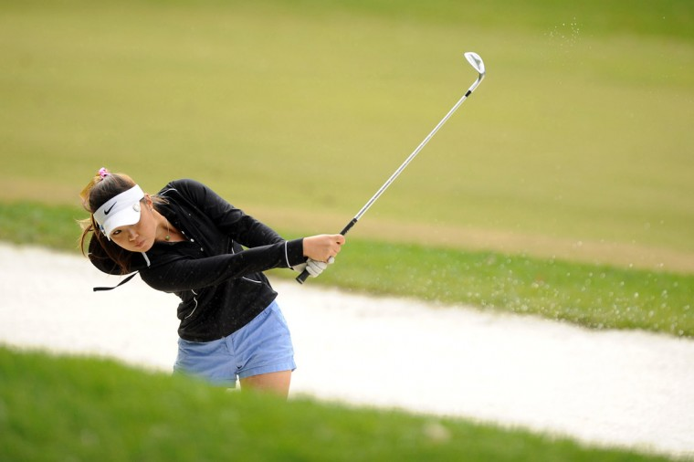 Rachel Lee of Marriotts Ridge hits safely out of a sand trap during the Howard County girls golf championship at Hobbits Glen Golf Course in Columbia on Tuesday, Oct. 16, 2012. (Brian Krista/Baltimore Sun Media Group)