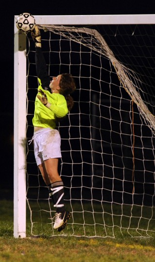 Glenelg goal keeper Kelly Geist jumps up to bat away a shot on goal by a River Hill player during a game at Glenelg High School in Glenelg on Friday, Sept. 21, 2012. (Brian Krista/Baltimore Sun Media Group)