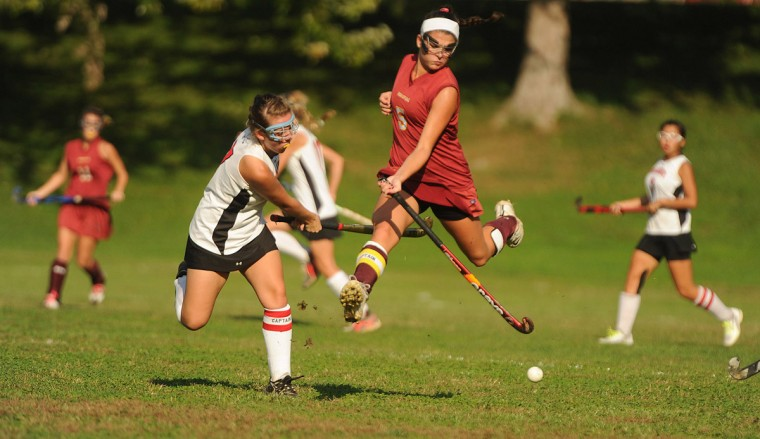 Hereford's Mary Claire Abbott, right, gets airborne in an attempt to stop a pass from Emily Edington of Dulaney during a field hockey game at Dulany High School in Timonium on Friday, Oct. 5, 2012. (Brian Krista/Baltimore Sun Media Group)