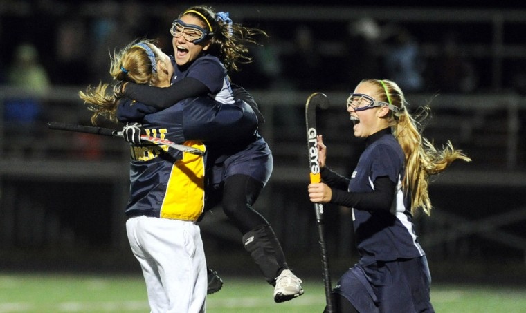 Rachel Saks of Catonsville jumps into the arms of a teammate as the team celebrates their 2-1 win over Walter Johnson in the state semifinal field hockey game at Franklin High School in Reisterstown on Wednesday, Nov. 7, 2012. Catonsville advances to the state championship on Saturday, Nov. 10. (Brian Krista/Baltimore Sun Media Group)