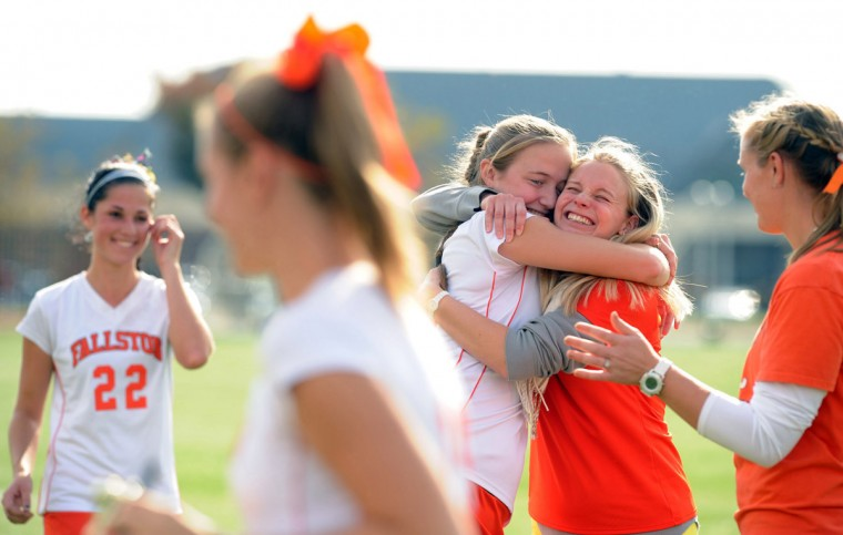 Fallston's assistant coach Deana Burke, right, embraces player Becky Streett as the team receives their trophies following their 2-0 win over Crisfield during the 1A state field hockey championship at Washington College in Chestertown on Saturday, Nov. 10, 2012. (Brian Krista/Baltimore Sun Media Group)
