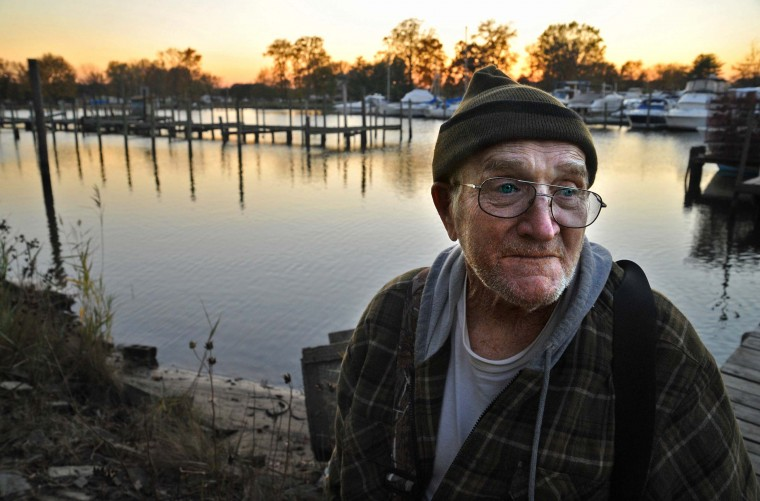 "Retired waterman Harry Foote, Jr., 74, near his home on Armstrong Creek. He has been on the water in eastern Baltimore County his entire life. ""As a kid in a 16-foot rowboat on Frog Mortar Creek, you didn't need a net. You just reached out by hand and picked up the crabs."" (Amy Davis/Baltimore Sun)"