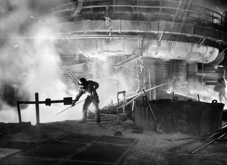 A workman in the blast furnace at Bethlehem Steel Co in October, 1951. (Robert F. Kniesche/Baltimore Sun)