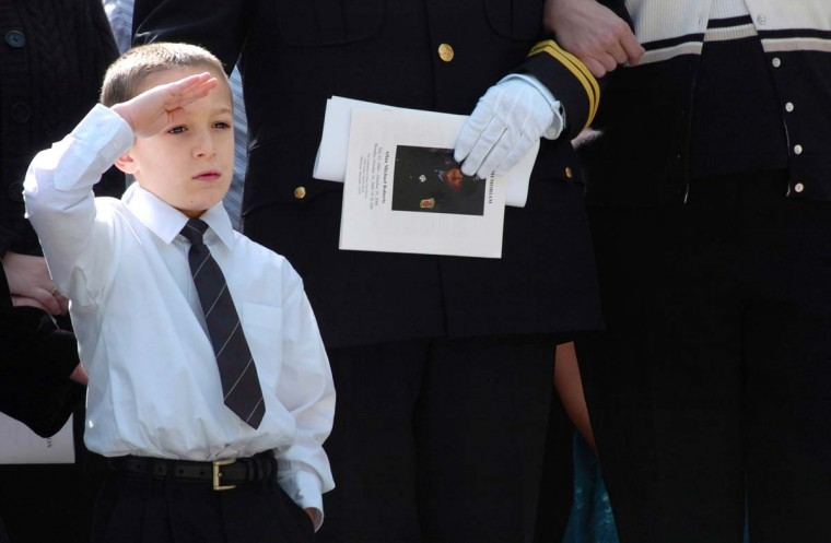 Jacob Roberts, 5, salutes the coffin of his father, Allan Michael Roberts, a Baltimore firefighter killed while battling a rowhouse fire in October 2006. (Algerina Perna/Baltimore Sun)