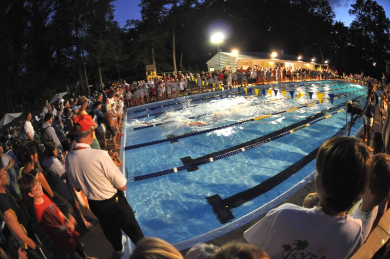 "Rob Lynch is this week's Reader Sunshots ""Suburbia"" winner for his photo of a community swim meet in Lutherville between teams from York Manor and Hampton. The photo was taken on an evening in late June with a Nikon D5000 and a 10.5 mm fish eye lens. Jerry Jackson, The Baltimore Sun's senior picture editor comments, ""Rob did a great job of capturing an iconic scene that plays out at community pools throughout the country every summer. His use of super wide lens and available light work together to add a sense of depth and scale."""