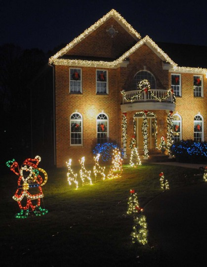 """The King of Christmas"" decorated this Timonium home with approximately 30,000 assorted Christmas lights, lawn decorations, plant and tree lights in time for the upcoming season. This particular job cost the home owner $2800.00, for installation and removal of all of the decorations, in January. (Gene Sweeney Jr./Baltimore Sun)"