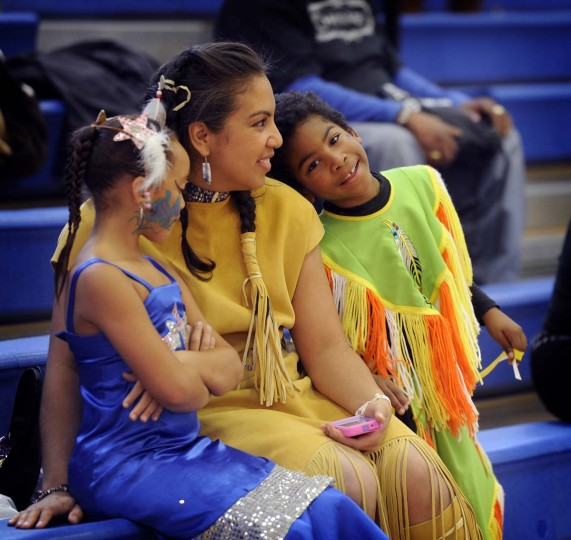 Christie Lincoln, center, sits with her niece Avani Johnson, left, and her son Carter Lincoln, 6, at the 38th annual Baltimore American Indian Center Powwow. They are from Baltimore and are part of the Wampanoag Tribe. (Barbara Haddock Taylor/Baltimore Sun)