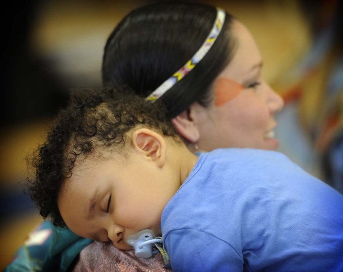 Anna Johnson holds her ten month old baby, Makai, at the 38th annual Baltimore American Indian Center Powwow. They are from the Crow Tribe and live in Rockville. (Barbara Haddock Taylor/Baltimore Sun)