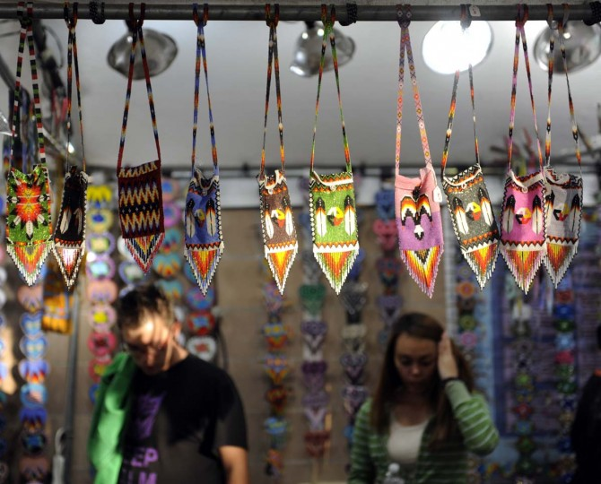 A display of beaded purses hangs from a bar at the 38th annual Baltimore American Indian Center Powwow. The beadwork is done by Richard Waller and 150 members of his family. (Barbara Haddock Taylor/Baltimore Sun)