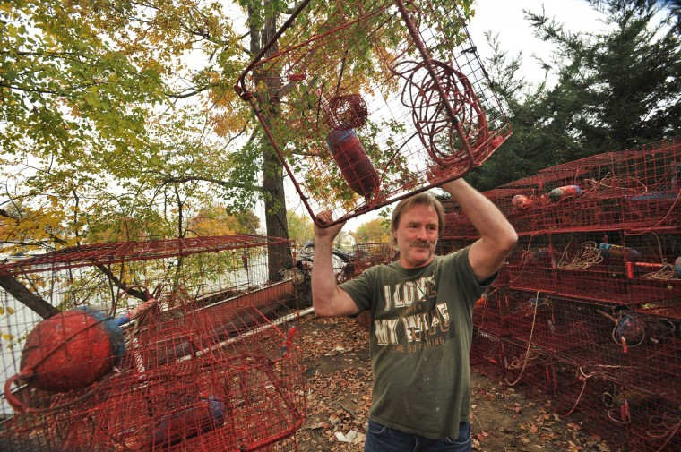 Waterman Harry Foote III, known as Captain Harry, stacks his cleaned crab pots at the end of the season. In season sells his crabs for take-out at Captain Harry's Ridge Crab House in Nottingham. (Amy Davis/Baltimore Sun)
