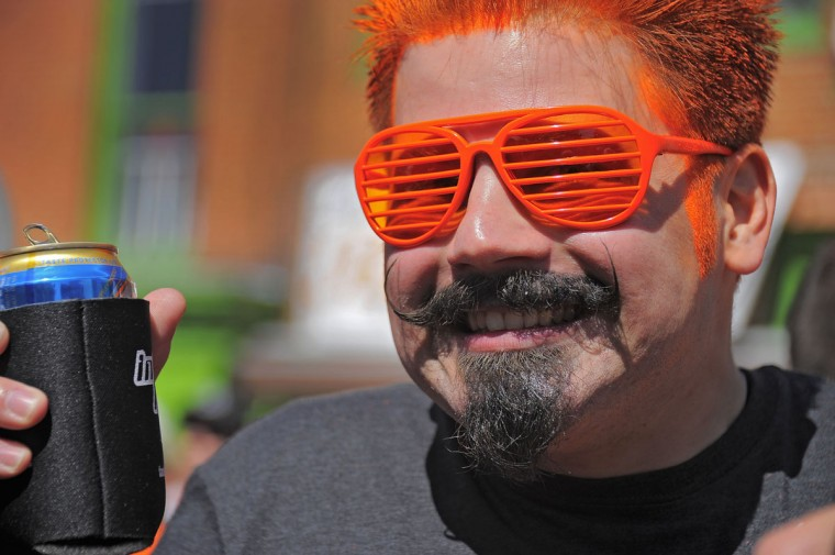 Baltimore Orioles fan Dan Petrowski wears orange shades and funky mustache with his orange hair outside Pickles Pub, across the street from the stadium (background) on Opening Day 2012 Friday, April 6, 2012. The city celebrates 20 years of the existence of Oriole Park at Camden Yards. (Karl Merton Ferron/Baltimore Sun)