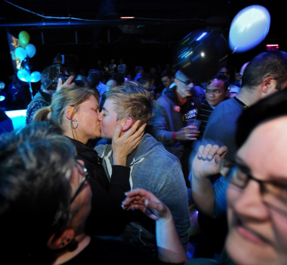 Gay couple and supporters of Question 6 for same-sex marriage, celebrate with a kiss after the question's passage at The Sound Stage on election night. (Kenneth K. Lam/Baltimore Sun)