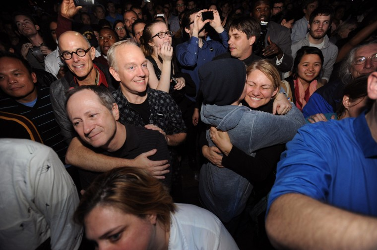 Supporters of Question 6 for same-sex marriage, gathered at The Sound Stage on election night, celebrate as the election is called for President Barack Obama by NBC Network. (Kenneth K. Lam/Baltimore Sun)