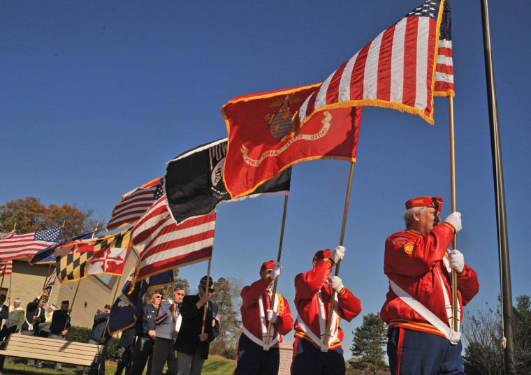 Sergeant of the Guard retire the colors at the closing of the Veterans Day ceremony held at the Crownsville Veterans Cemetery. (Amy Davis/Baltimore Sun)