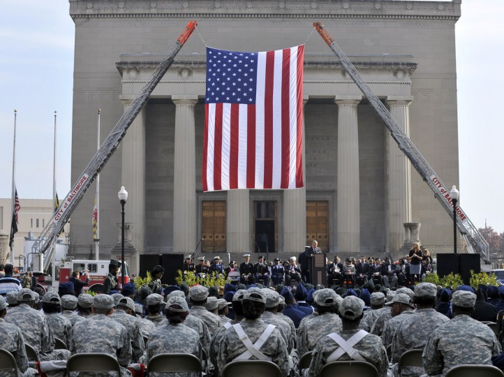 Mayor Stephanie Rawlings-Blake led a march of dignitaries, veterans, and military personnel down Charles Street from the Washington Monument (Charles & Centre Streets) to the ceremonial stage at the War Memorial Plaza. (Lloyd Fox/Baltimore Sun)