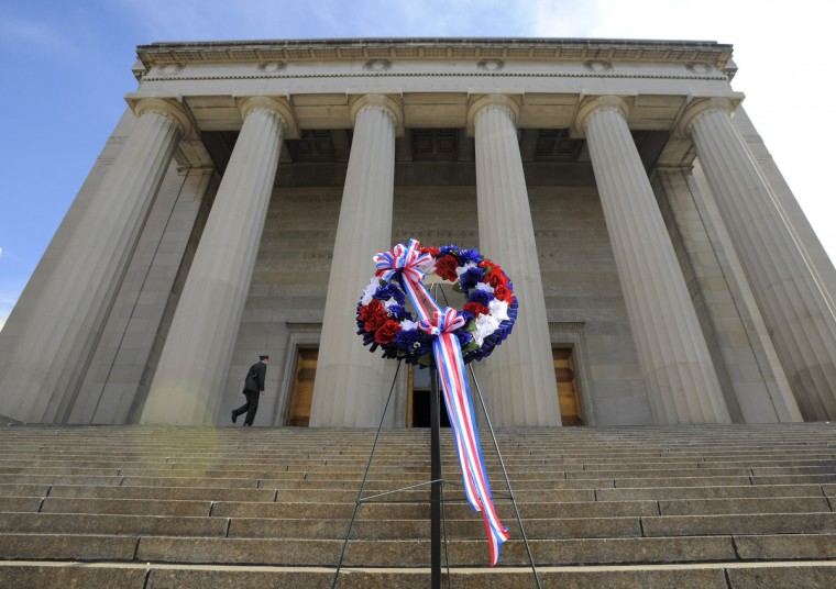 A wreath was placed in front of the War Memorial in honor of the veterans who fought for the United States. (Lloyd Fox/Baltimore Sun)