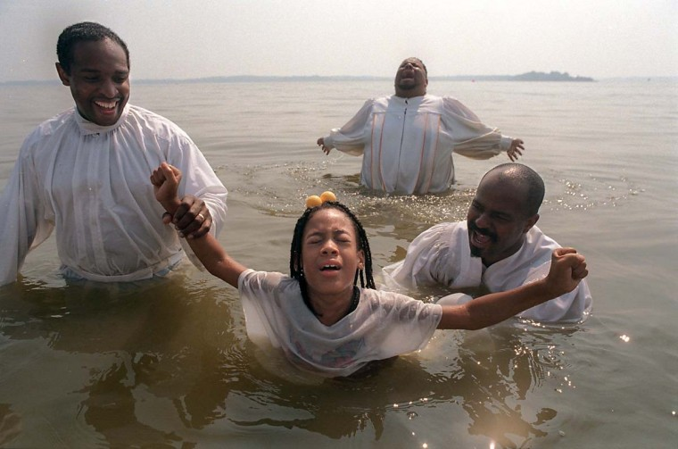 Called by the spirit, three churches hold a mass baptism through immersion in the waters of Big Gunpowder Falls in August 1996. (Linda Coan/Baltimore Sun)