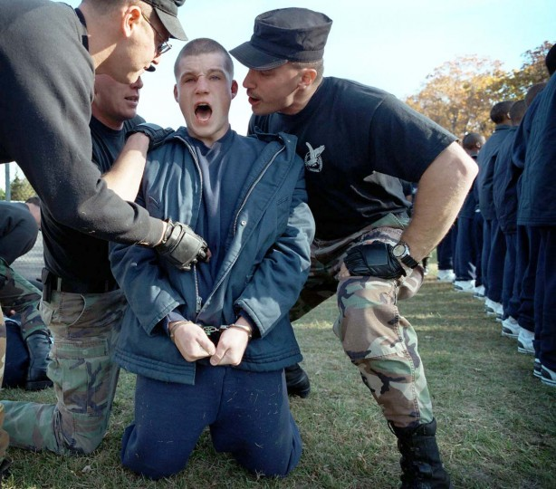 "Tactical officers teach 17-year-old James Phelps the importance of saying ""sir"" on the first day of boot camp for juveniles at the Savage Mountain Youth Center in Western Maryland. André F. Chung/Baltimore Sun)"