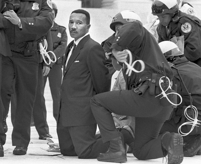 As head of the NAACP, Kweisi Mfume, a former Baltimore city councilman and U.S. representative, was among those arrested during a protest of discriminatory hiring practices at the Supreme Court in 1998. (Elizabeth Malby/Baltimore Sun)