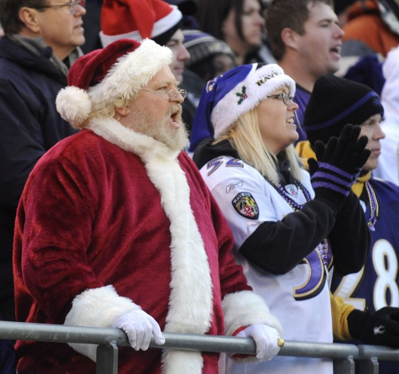 Ravens fans, including many dressed as Santa, cheer on Baltimore as they beat Cleveland 20-14. Baltimore Ravens vs. the Cleveland Browns at M&T Bank Stadium on December 24, 2011. (Gene Sweeney Jr./Baltimore Sun)