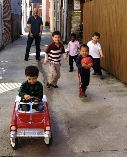"The winner for this week's Reader SunShots series ""City Life"" goes to Albert W. Wu for his picture of kids playing in an alley way during birthday party. The picture was taken with an iPhone 4S. Here is a critique by director of photography Robert Hamilton. ""Everything about this picture says urban life. From the alley way as a setting, to the racial mixture of the children, fueled by cupcakes, playing together. Even the attentive parent enjoying the scene in the background adds to the picture. There is just a beautiful energy to this photograph."""
