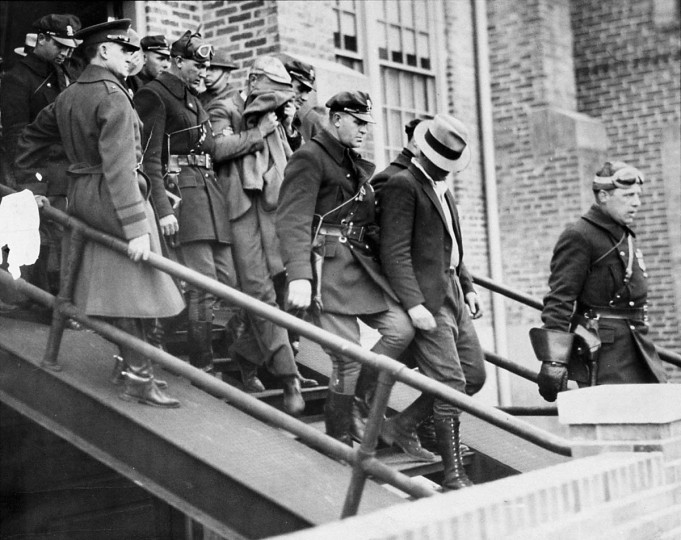 In November of 1933 guardsmen escort lynching suspects from the Salisbury Armory bound for Baltimore City Jail. (Robert F. Kniesche/Baltimore Sun)