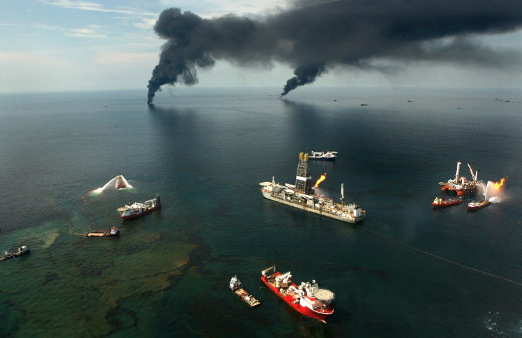 June 19, 2010 - Fires burn around the site of the BP Deepwater Horizon rig site in the Gulf of Mexico. (Carolyn Cole/Los Angeles Times)