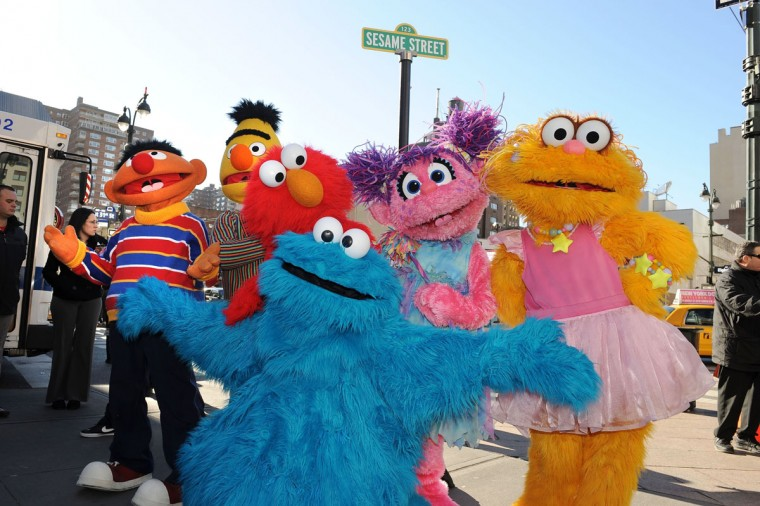 "Sesame Street Live characters Ernie, Bert, Elmo, Abby Cadabby, Zoe and Cookie Monster celebrate the renaming of a corner in New York to ""Sesame Street."" (Stan Honda/AFP/Getty Images)"