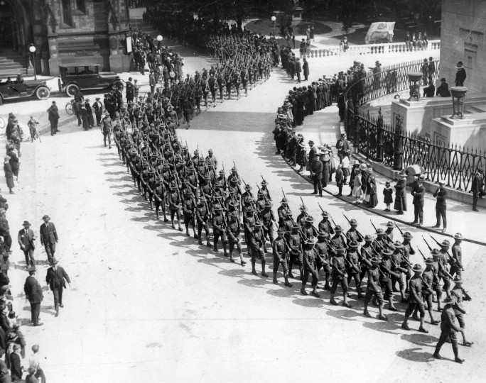 "An Armistice Day parade marches smartly by the Washington Monument in Mount Vernon Place on November 11, 1918, marking the end of the ""war to end all wars."" (Baltimore Sun)"