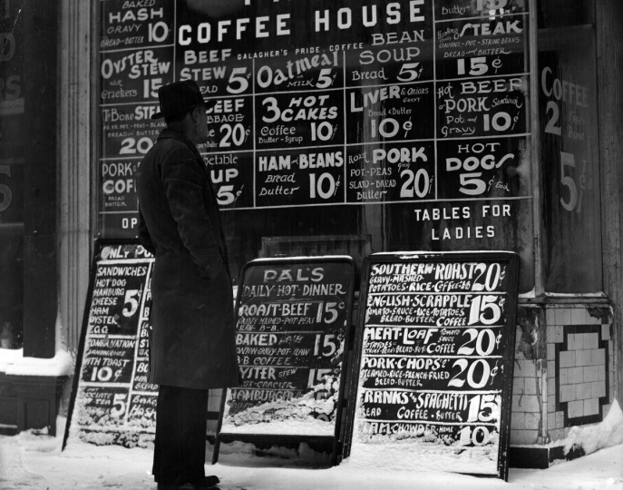 "Everything from ham and beans to beef stew and hot dogs was available at the coffee house. Also advertised were ""Tables for Ladies,"" in this photo from the early days of the Depression. (A. Aubrey Bodine/Baltimore Sun)"