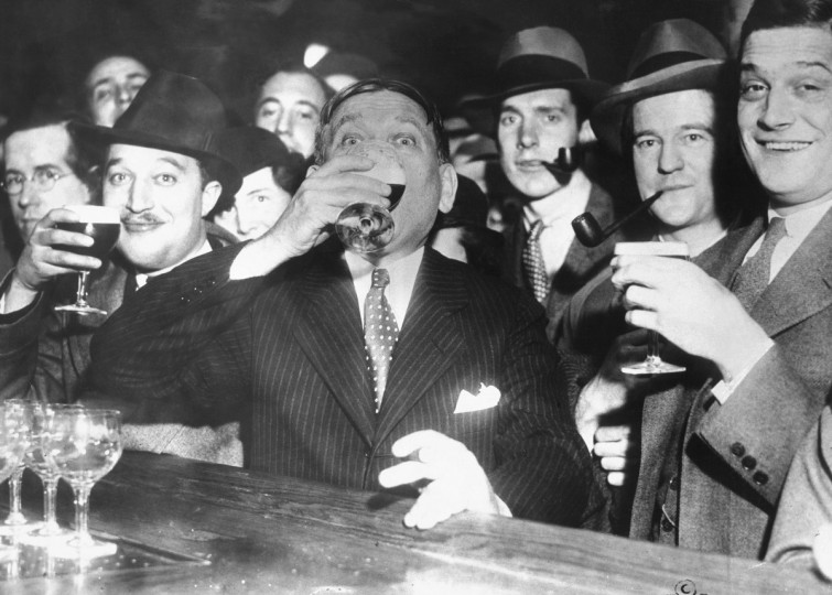 "At 12:29 a.m. April 7, 1933, H.L. Mencken, ""the Bard of Baltimore,"" marks the end of Prohibition with a glass of Arrow Beer at the Rennert Hotel. ""Pretty good,"" he says. ""Not bad at all."" (Frank A. Miller/Baltimore Sun)"