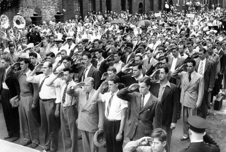 Navy recruits salute after taking the oath at Flag House in Baltimore in June 1942. Thousands of brave Marylanders heeded their country's call. (Baltimore Sun)