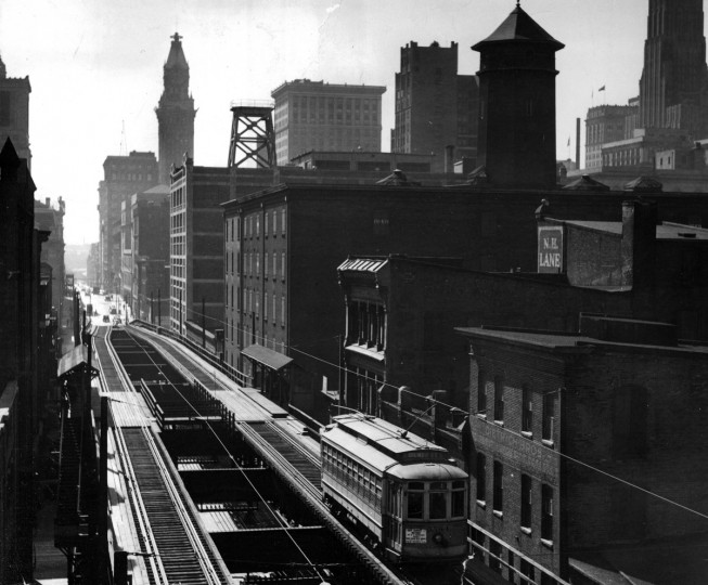 A streetcar travels the Guilford Avenue Elevated line in 1940. The streetcar-only trestle extended from Saratoga to Biddle Street from 1895 to 1950. (Baltimore Sun)