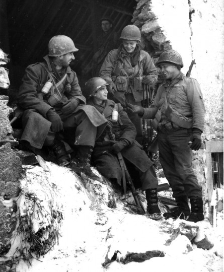 Staff Sgt. Worton Cohen of Baltimore and members of the Yankee Division take a break from the war after the victory at Ardennes in February 1945. (Lee McCardell/Baltimore Sun)
