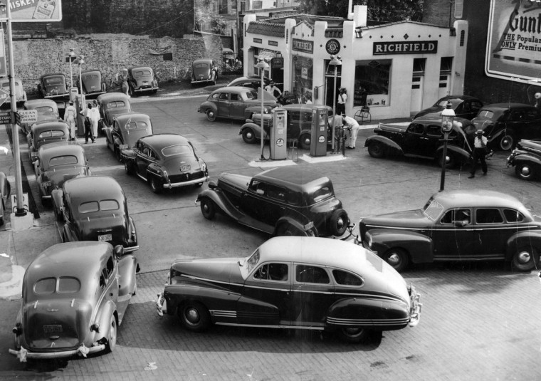 Cars and owners line up for gasoline rations at a Richfield station at Gilmore Street and Lafayette Avenue in Baltimore during World War II. (Baltimore Sun)