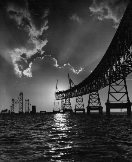 The Bay Bridge nears completion in March 1952. Soon, motorists would no longer have to take the ferry across the Chesapeake Bay or make the long trek around it. (A. Aubrey Bodine/Baltimore Sun)