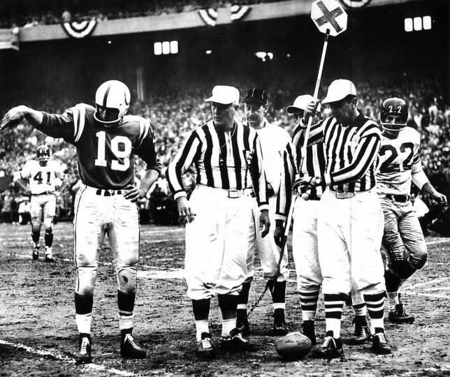 Johnny Unitas checks a first-down measurement in the 1959 NFL title game at Memorial Stadium. The Colts would repeat as champions, defeating the New York Giants again, 31-16. (Joseph A. DiPaola Jr./Baltimore Sun)