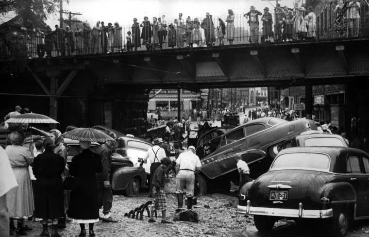 Tropical Storm Able brought heavy rain and flash flooding on September 1, 1952, that turned Main Street in Ellicott City into a torrent and swept cars toward the Patapsco River. (Frank A. Miller/Baltimore Sun)