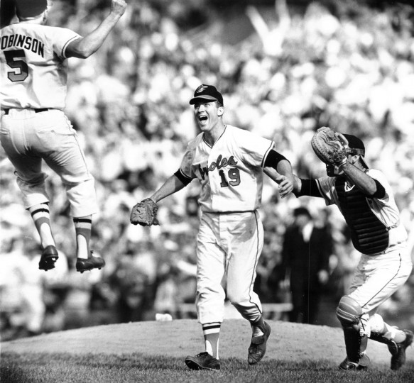 Third baseman Brooks Robinson and catcher Andy Etchebarren converge on pitcher Dave McNally after the Orioles swept the Los Angeles Dodgers in 1966 to win their first World Series. (Paul M. Hutchins/Baltimore Sun)