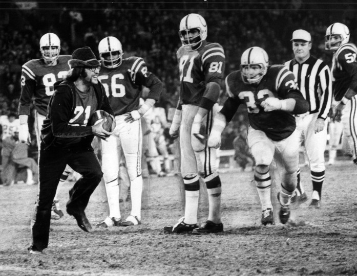 Colts linebacker Mike Curtis, right, goes after Donald W. Ennis, left, of Rochester, N.Y., who grabbed the ball during a game in December 1971. Curtis decked the fan, but Ennis got up smiling. (Carl D. Harris/Baltimore Sun)